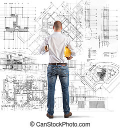 Projects of a building - Architect looks at projects of a...