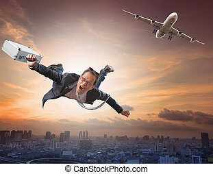 crazy business man flying from passenger plane with glad and...