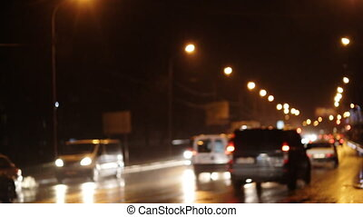 Lighting street in a big city, bokeh from cars light on the...