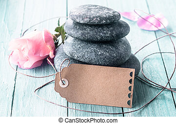 Black stones with roses and tag - Stack of four smooth black...