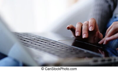 Close up of female hands typing a message or correcting a text on her laptop.