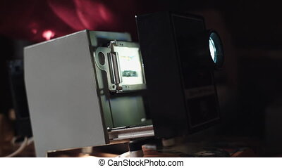 Man shows photos on the slide projector - Man shows family...