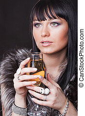 Woman with glass of sparkling wine
