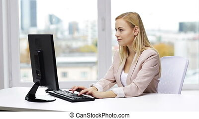 businesswoman with computer typing at office - business,...