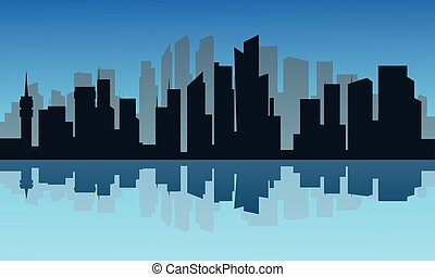 Silhouette of city and reflection at night