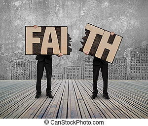 Men holding two cracked FAITH word wooden boards - Men...