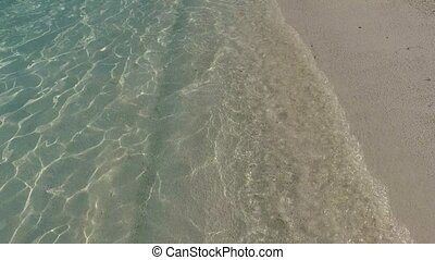 sea water splashing on beach - travel, tourism, vacation and...