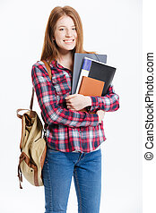 Smiling female student standing with book