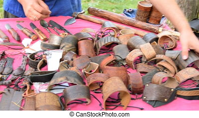 Handmade leather bracelets for sale - Vendor adjusting...
