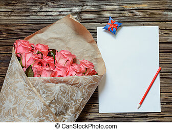 Pink roses with blank paper and colored pencil - Brown bag...