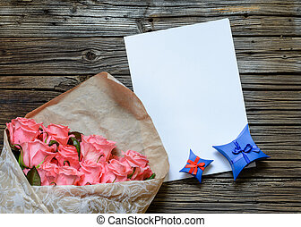 Bag of roses with blank paper and gift box - Brown bag of...