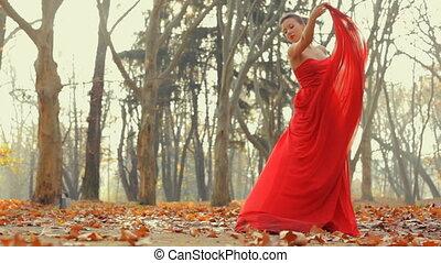Beautiful young model wearing long evening red dress...