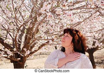Beautiful real 45 years old woman standing in the park