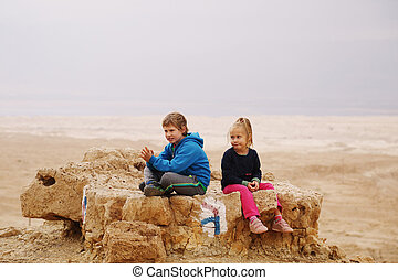 Portrait of 5 years girl with her autistic 8 years old brother outdoors