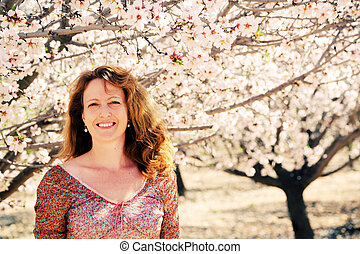 Spring portrait of beautiful 40 years old woman outdoors