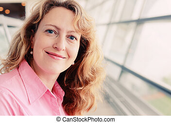 Portrait of beautiful 35 years old woman with cup of coffee