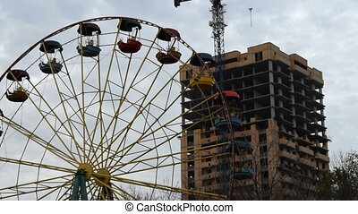 Old Ferris wheel and unfinished construction