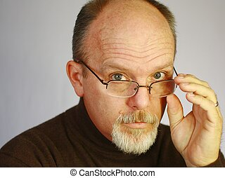Handsome bald man with goatee looking over glasses - Bald...