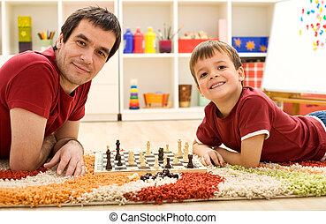 Look I am beating dad at chess