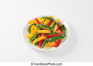 Sliced Mixed Peppers - Plate of three color bell pepper...