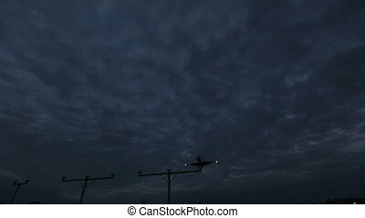Plane landing Dark cloudy sky background