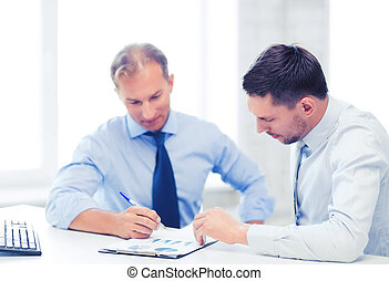 businessmen with notebook on meeting - businesss concept -...