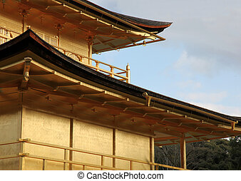 Close up of architectural detail of Kinkakuji - The famous Golden Temple from Kyoto, Japan.   Construction of the original building was commenced in 1397 initially as the house of a retired Shogun a