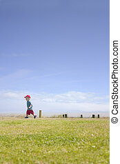 cute toddler running by sea - a cute toddler running in the...