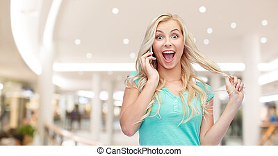 smiling young woman calling on smartphone - emotions,...