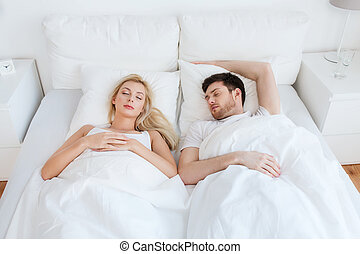 happy couple sleeping in bed at home - people, rest and...