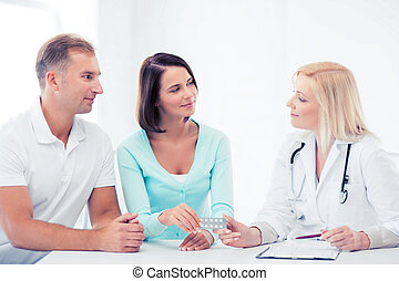 doctor giving pills to patients - healthcare and medical -...