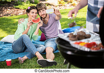 Selfie on a garden barbecue - Happy friends taking selfie on...