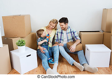 happy family with boxes moving to new home - mortgage,...