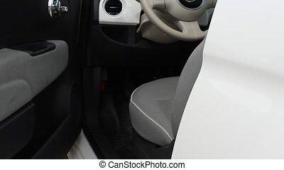 Hand Closing Door of White Car - Hand of white man closing...