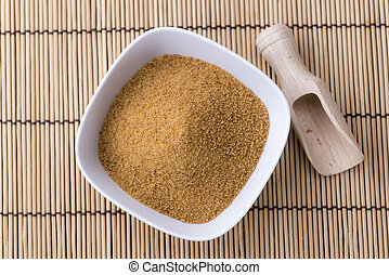 Coconut Sugar (selective focus) on vintage wooden background