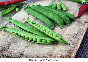 Green peas on the wood backgraund.