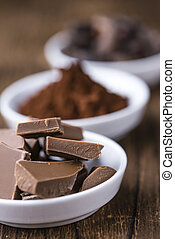 Milk Chocolate (selective focus) on wooden background...