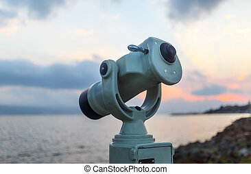 Coin operated monocular - Public monocular on sea shore Coin...