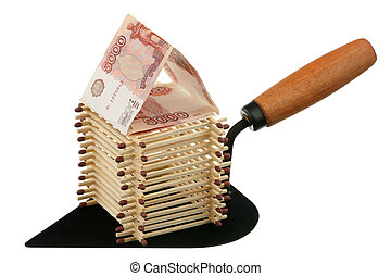 Matches and currency - Matches on a building trowel on a...