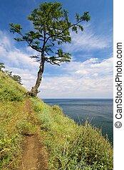 Lake Baikal - shore of Lake Baikal near the town of...