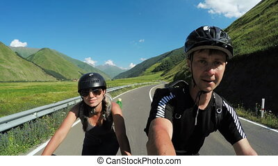 Couple on bike in mountains