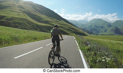 Girl on bike in mountains