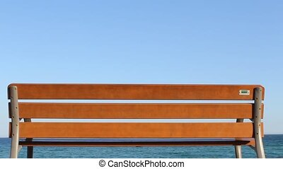 Walking People at Wooden Bench - Wooden Bench at the ocean....