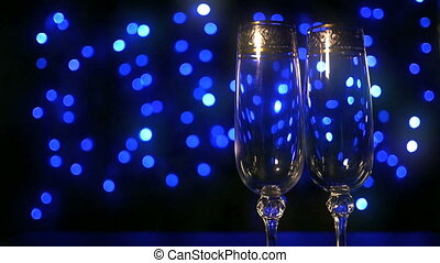 Empty glasses for champagne stand on boke background
