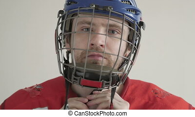 Young Ice Hockey Player Portrait wearing Helmet on White...