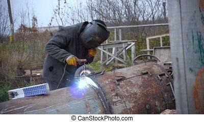 Welders Repairing Heavy Equipment Outdoor - Welders...