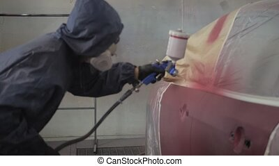 Footage of a Car being Painted by Painting Gun - Footage of...