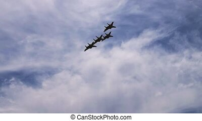 Fighter planes in blue sky - Four fighter planes flying in...