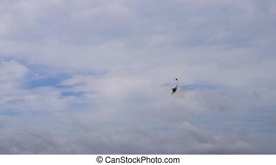 Fighter plane performing in cloudy sky - Fighter supersonic...