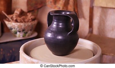 Beautiful clay Potters jug rotating on a spinning wheel
